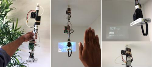 天井などの任意の表面に固定できるロボットアーム型プロジェクターカメラシステム