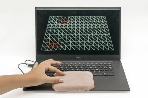 人工皮膚をつねったりなぞったりして入力するインターフェース技術